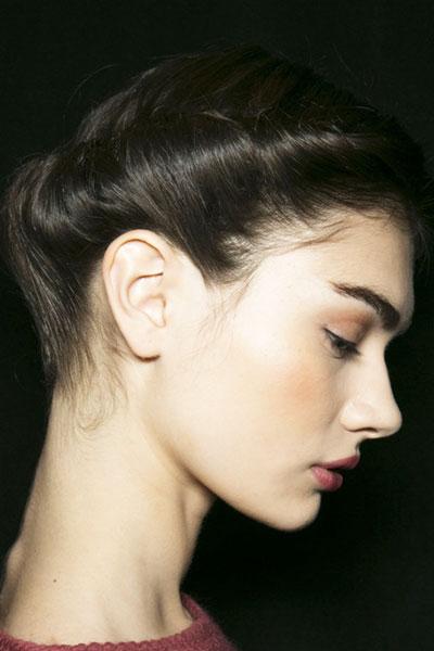 Antonina Vasylchenko's Elegant Rolled Updo Hairstyle