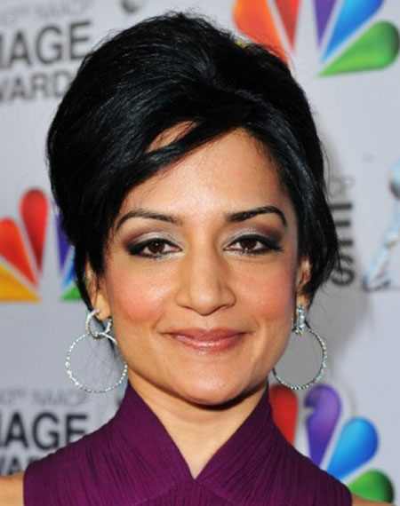 Archie Panjabi's Vintage Beehive Updo with Side Bangs