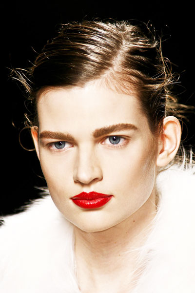 Bette Franke's Edgy Wet Look Updo Hairstyle