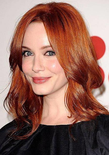 Christina Hendrick's Red Layered Medium Wavy Hairstyle