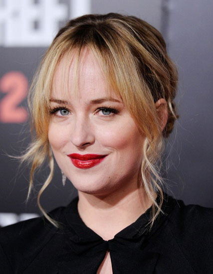 Dakota Johnson's Sophisticated Low Chignon with Blunt Bangs