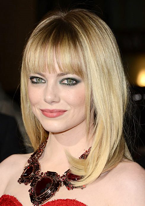 Emma Stone's Face Framing Layered Hairstyle With Blunt Bangs
