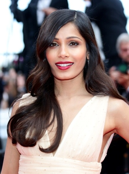 Freida Pinto's Side Parted Long Wavy Hairstyle At Cannes 2014