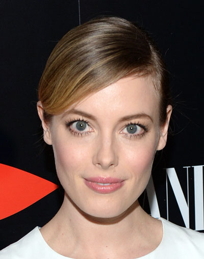 Gillian Jacobs' Simple Sleek Deep Side Part Bun Hairstyle