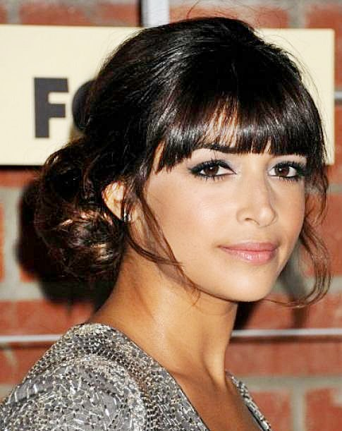 Hannah Simone's Sophisticated Low Bun Hairstyle with Blunt Bangs