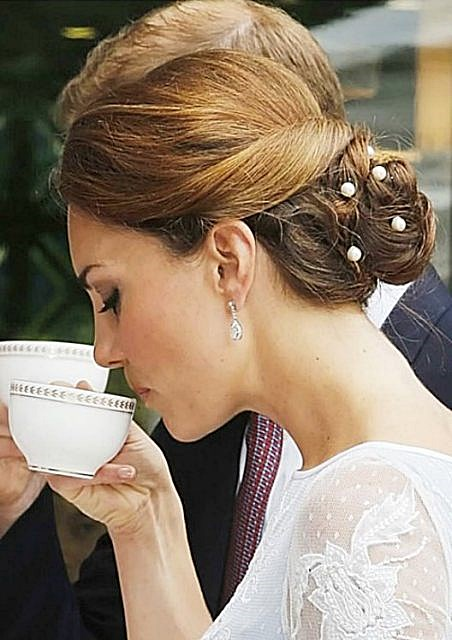 Kate Middleton's Classic Twisted Low Bun Hairstyle For Weddings