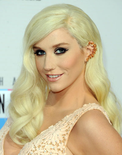 Kesha's Sultry Retro Long Curly Hairstyle