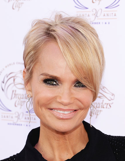 Kristin Chenoweth's Trendy Pixie with Long Side Bangs Hairstyle