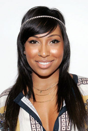 Melanie Fiona's Bohemian Chic Long Layered Hairstyle with Thin Headband