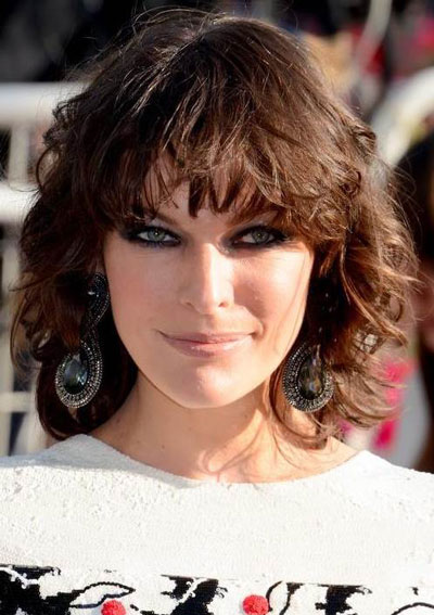 Milla Jovovich's Edgy Curly Bob with Bangs