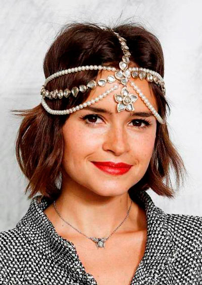 Miroslava Duma's Chic Messy Bob with Elaborate Headpiece