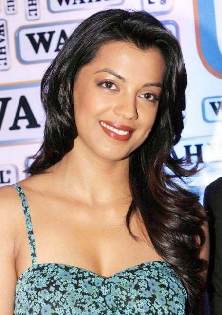 Mugdha Godse's Versatile Long Curly Hairstyle
