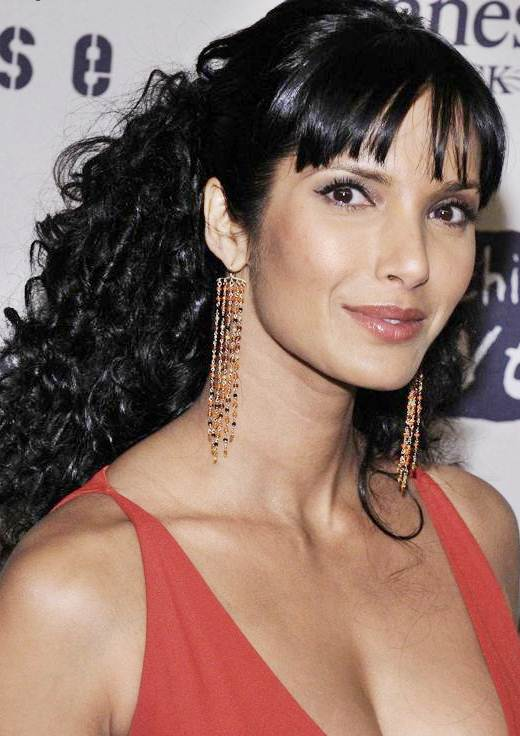 Padma Lakshmi's Funky Curly Half Updo With Blunt Bangs