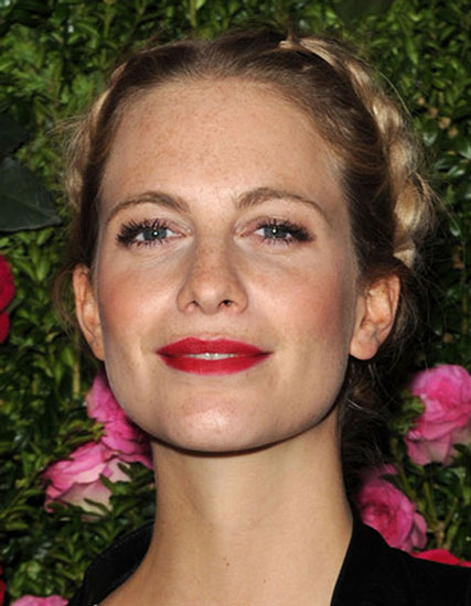 Poppy Delevingne's Romantic Reversed Milkmaid Braid Updo
