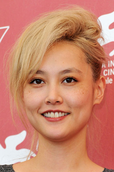 Rinko Kikuchi's Fun and Quirky Messy Updo with Deep Side Part