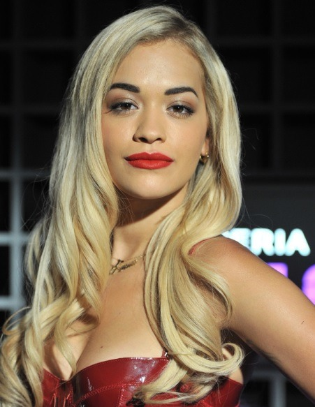 Rita Ora Long Side Parted Blond Wavy Hairstyle