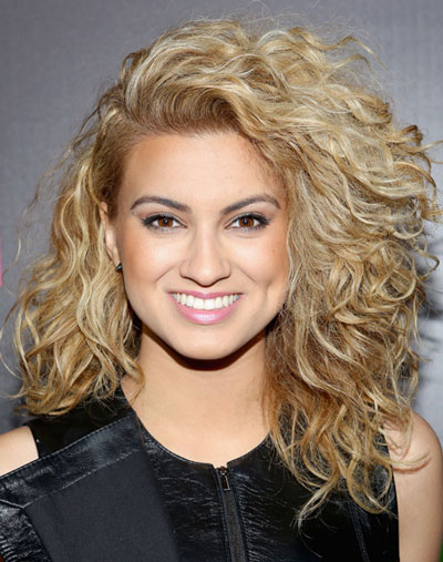 Tori Kelly's Wild Curly Side Part Hairstyle