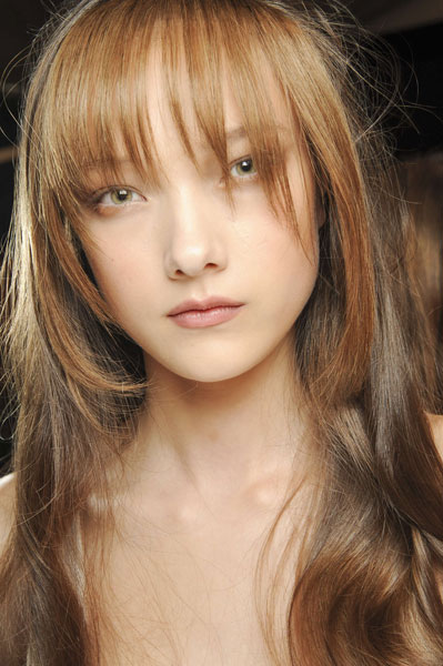 Yumi Lambert's Glamorous Long Layered Hairstyle with Bangs