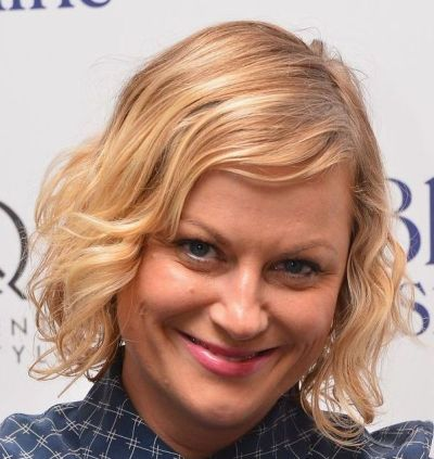 Amy Poehler's Chin-Length Curly Blonde Hair In Playful Hairstyle