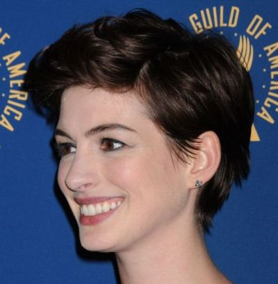 Anne Hathaway's Brown Hair In A Short Curly Mature Hairstyle