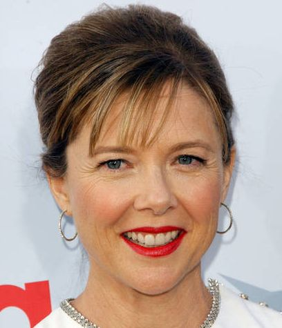 Annette Bening's Brown Hair In Simple Updo With Wispy Bangs
