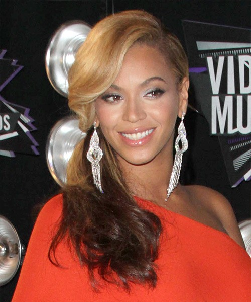 Beyonce's Long Hair Is Secured In A Low Side Ponytail.