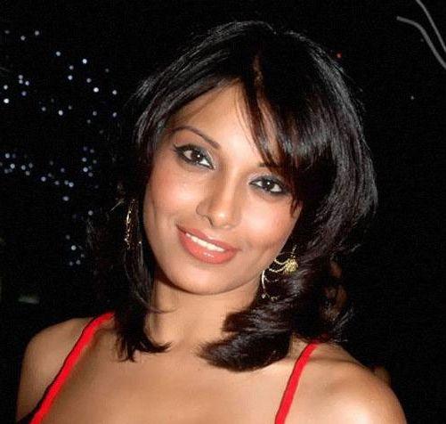 Bipashu Basu's Medium-Length Brown Hair In Curly Hairstyle