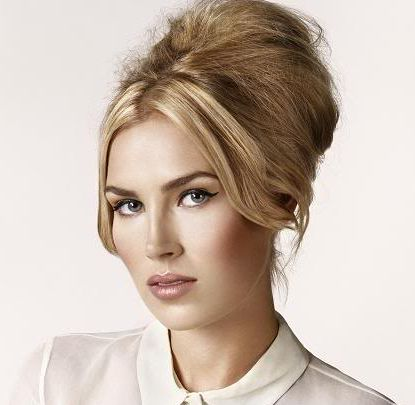 Blonde Hair In Beehive Formal Hairdo With Long Parted Bangs