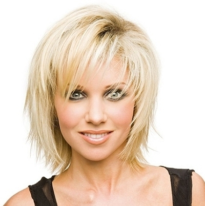 Platinum Blonde Straight Shag Hairstyle With Bangs Teased For Volume