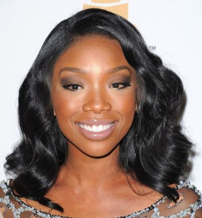 Brandy's Black Hair In Wavy Medium-Length Hairstyle