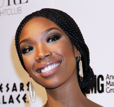 Brandy With Tightly Braided Black Hair In Chignon Hairdo