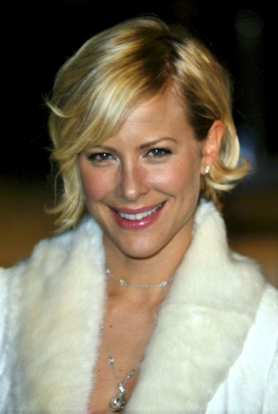 Brittany Daniel Short Blonde Chic Flirty Layered Wedge Hairstyle