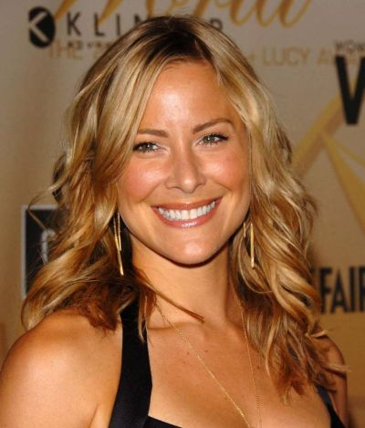 Brittany Daniel's Medium-Length Blonde Hair In Layered Hairstyle