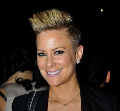 Brittany Daniel's Short Blonde Straight Hair In Gelled Up Hairstyle