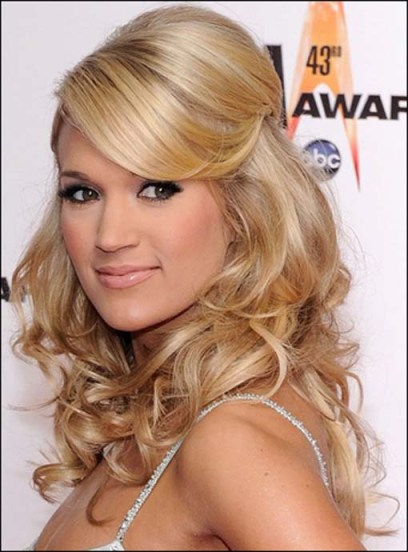 Carrie Underwood's Long Blonde Hair Is Curly And Very Feminine.