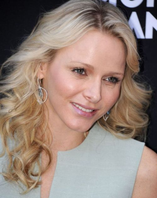 Charlene Wittstock's Long Blonde Hair In Curly Layered Hairstyle