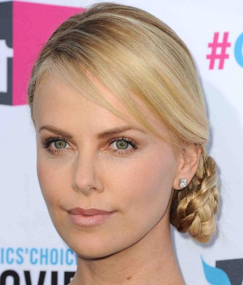 Charlize Theron's Blonde Hair In Elegant Braided Side Chignon Hairdo