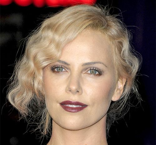 Charlize Theron's Blonde Hair In Formal Wavy Half Updo