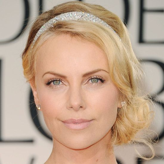 Charlize Theron's Wavy Blonde Hair In Romantic Side Chignon Hairdo