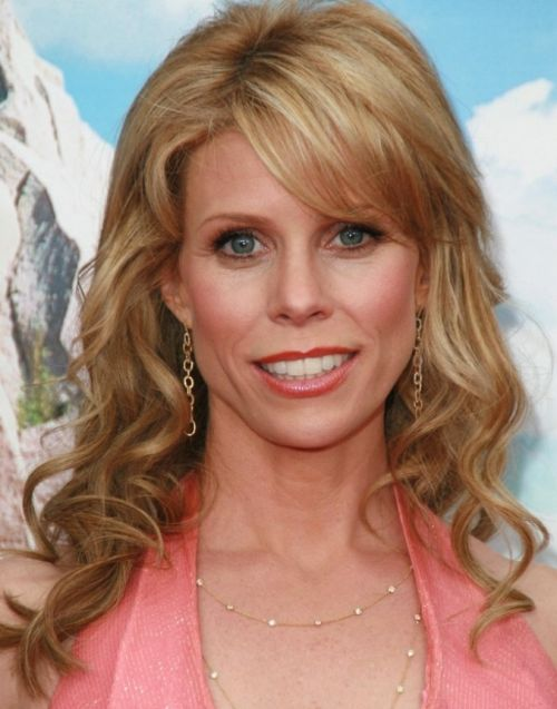 Cheryl Hines's Long Copper Blonde Hair In Curly Hairstyle
