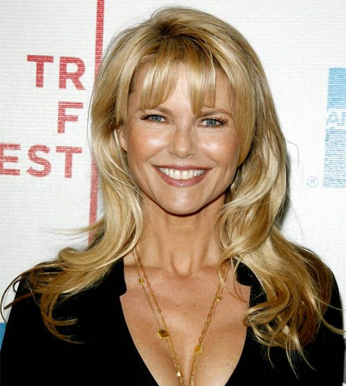 Christie Brinkley's Long Blonde Hair In Layered Hairstyle With Bangs