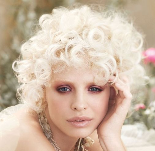 Curly Platinum Blonde In Short Playful Sassy Hairstyle