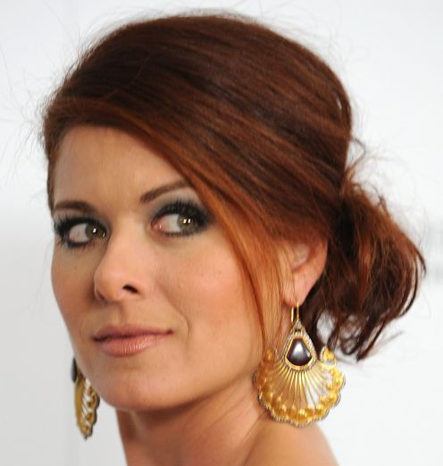 Debra Messing's Long Auburn Hair In Messy Chignon Formal Hairdo