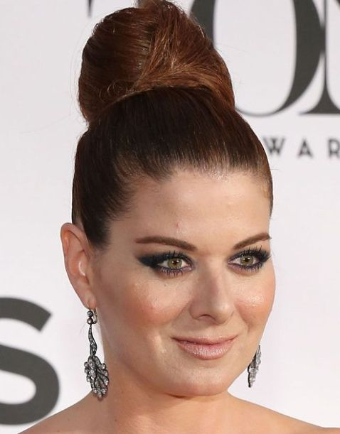 Debra Messing's Long Straight Auburn Hair In Sleek Top Knot