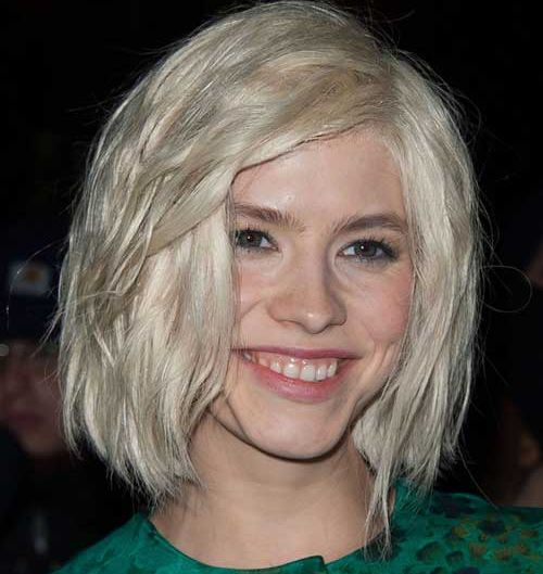 Elena Perminova's Platinum Blonde Hair In Short Wavy Wedge Hairstyle