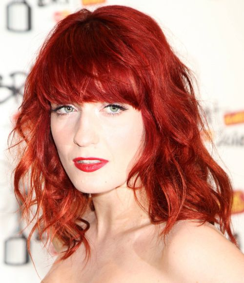 Florence Welch's Bright Red Medium-Length Wavy Hairstyle