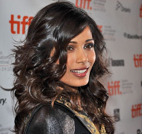 Freida Pinto's Long Dark Brown Hair In Layered Curly Hairstyle