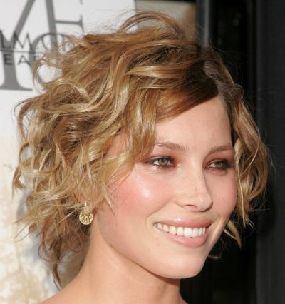 Jessica Biel's short blonde hair is cut in a layered wedge hairstyle ...