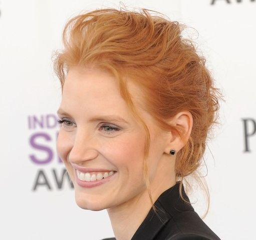 Jessica Chastain's Curly Red Hair In Loose Chignon Updo Hairdo