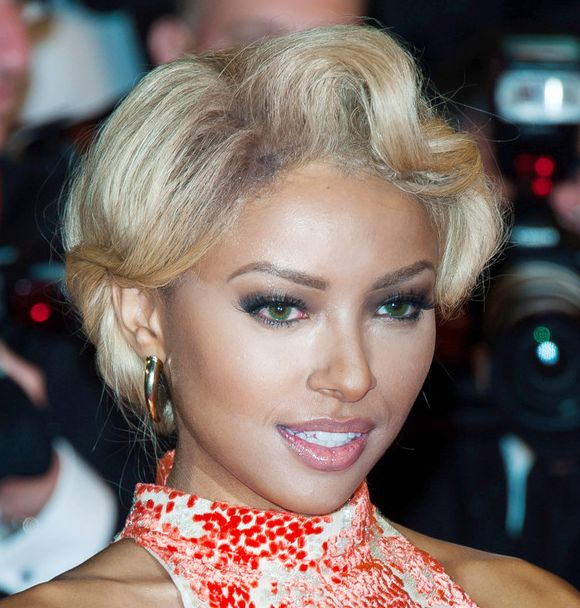 Kat Graham's Blonde Highlighted Hair In Short Wavy Hairstyle